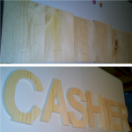 """CASHIER"" Letters rough before paint."